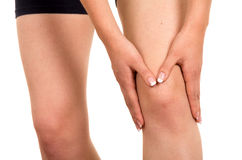 Young beautiful woman with knee pain Royalty Free Stock Image