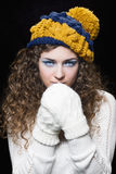 Young beautiful woman in knitted funny hat royalty free stock images