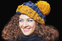 Young beautiful woman in knitted funny hat royalty free stock image