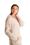 Young beautiful woman in a knitted garment Royalty Free Stock Photos