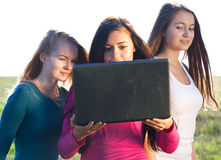Young beautiful woman with a laptop Stock Photography