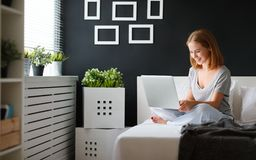 Young beautiful woman with  laptop and  cup of coffee in   morni Stock Photography