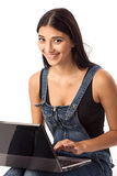 Young beautiful woman with a laptop over white Stock Photo