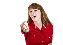 Young beautiful woman laughing and pointing at someone with her finger Stock Image