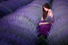 Young beautiful woman in lavender fields with a romantic mood