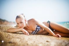 Young beautiful woman laying on the beach, coast Stock Image