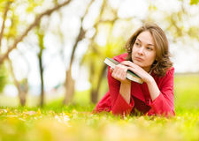Young beautiful woman lays on a grass Royalty Free Stock Photos