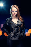 Young beautiful woman in leather jacket Royalty Free Stock Photography