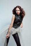 Young beautiful woman in leather jacket and tutu Stock Image
