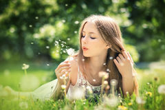 Young beautiful woman lies on a grass Royalty Free Stock Photography