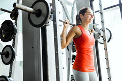 Young beautiful woman lifting weights in a gym Royalty Free Stock Image