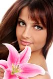 Young and beautiful woman with lily flower Stock Photo