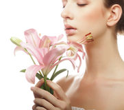 Young beautiful woman with a lily flowers. Royalty Free Stock Images