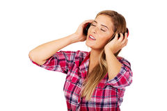 Young beautiful woman listen music Stock Image