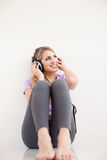 Young beautiful woman listen music with headphones Stock Photos