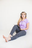 Young beautiful woman listen music with headphones Stock Photography