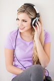 Young beautiful woman listen music with headphones Stock Image
