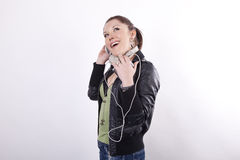 Young beautiful woman listening music. And smiling Royalty Free Stock Photo
