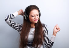 Young beautiful woman listening the music from headphones with d Royalty Free Stock Photo