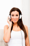 Young beautiful woman listening to audio Royalty Free Stock Photo
