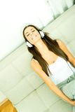 Young beautiful woman listening to audio Royalty Free Stock Photography