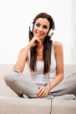Young beautiful woman listening to audio Stock Images