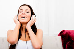 Young beautiful woman listening to audio Royalty Free Stock Images