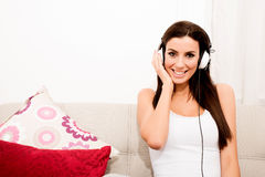 Young beautiful woman listening to audio Royalty Free Stock Image