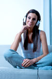 Young beautiful woman listening to audio Stock Photo
