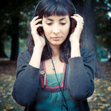 Young beautiful woman listening to music autumn Royalty Free Stock Photography