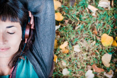 Young beautiful woman listening to music autumn Royalty Free Stock Photos