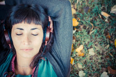 Young beautiful woman listening to music autumn Stock Photo