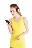 Young beautiful woman listening to music with headphones. Royalty Free Stock Photos