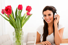 Young beautiful woman listening to music Stock Photos