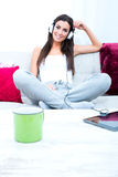Young beautiful woman listening to music with a Tablet PC at hom Royalty Free Stock Photos