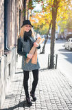 Young beautiful woman with a loaf of bread in her hands in autumn outdoors. Young beautiful woman with a loaf of bread in her hands in autumn. Outdoors portrait royalty free stock photos