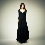 Young beautiful woman in long black dress Royalty Free Stock Image