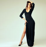 Young beautiful woman in long black dress Stock Photography