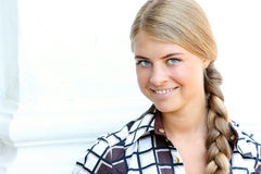 Young beautiful woman with long blonde queue Royalty Free Stock Photography