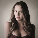 Young beautiful woman with long brown hair Stock Photo