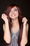 Young beautiful woman with long brown magnificent hair.  Closeup Stock Images