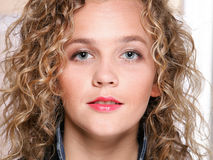 Young beautiful woman with long curly blond hair Royalty Free Stock Image