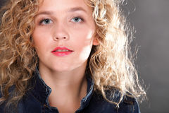 Young beautiful woman with long curly blond hair Stock Photos