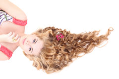 Young beautiful  woman with long curly hair lying Royalty Free Stock Photo