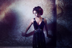 Young beautiful woman in long dress against the Royalty Free Stock Image