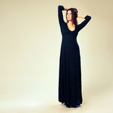 Young beautiful woman in long dress Royalty Free Stock Photography