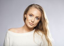 Young beautiful woman with long hair and blue eyes Stock Images