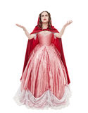 Young beautiful woman in long medieval dress and red cloak isolated. On white royalty free stock photos