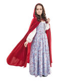 Young beautiful woman in long medieval dress and red cloak. Isolated royalty free stock images