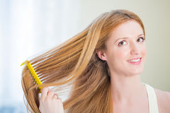 Young beautiful woman with long well maintained hair Stock Image